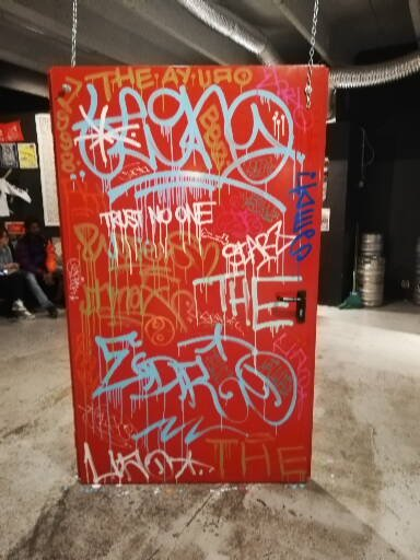 red door with tag